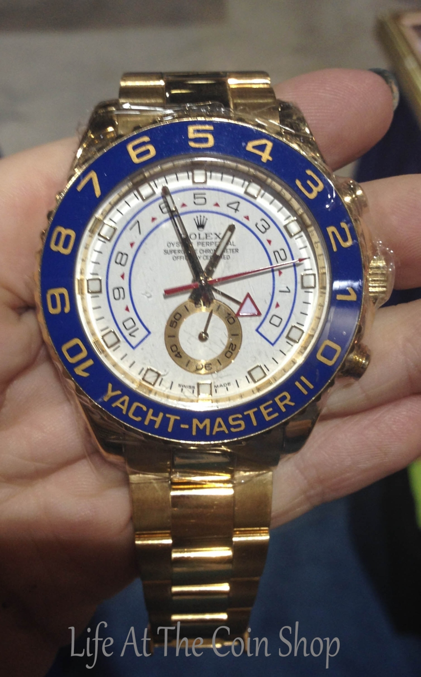 A giant gold Rolex Yachtmaster 2 we bought at the show.