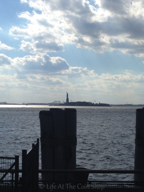 The Statue of Liberty on the horizon.